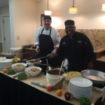 Chef Justin and Chef Bobby team up to prepare the dish for our community!