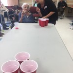 Our HR Director shows a resident how to play Beer Pong!
