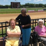 A few residents get ready for the horse races to begin!