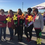 Some of our team holding Forget Me Not flowers - each color have a specific meaning!