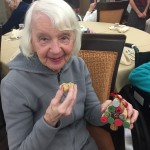 Barbara is all smiles with her cookie and ornament from the 5th graders!