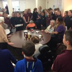 Resident, Joanne S. sang a holiday carol for the students. They enjoyed this song very much and gathered around her as she sang.